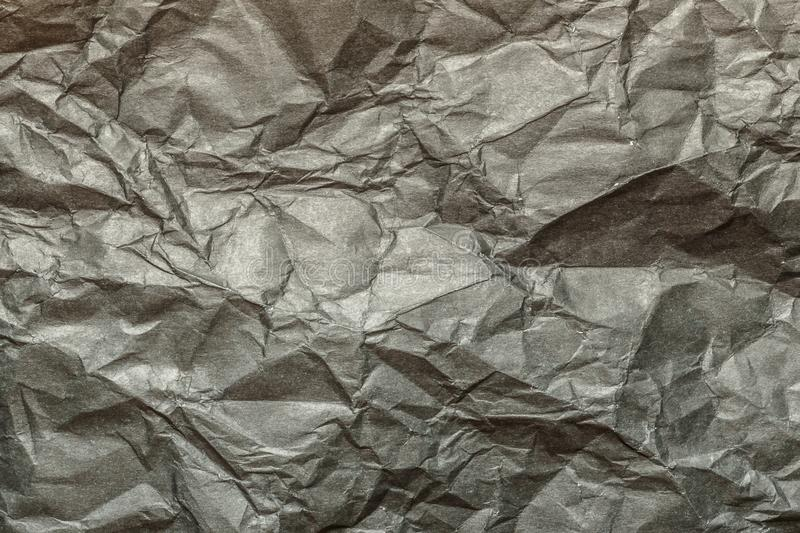 Crumpled paper background texture for usage in design stock photography
