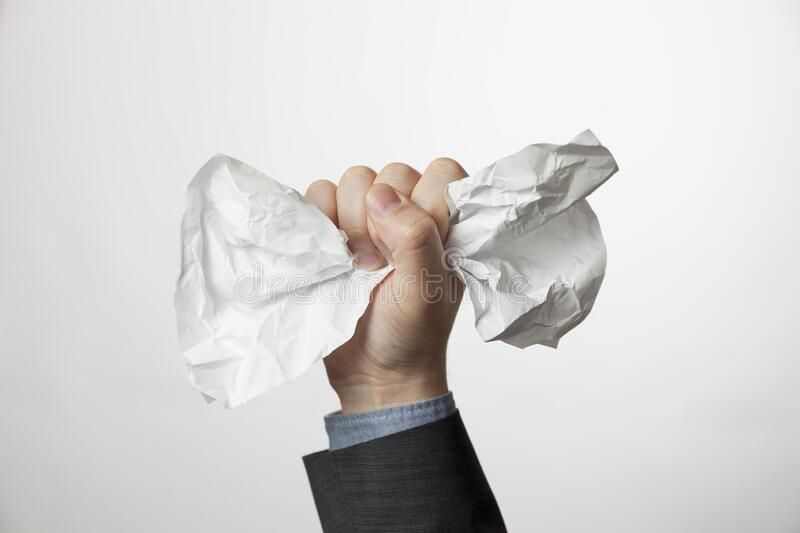 Crumpled A4 paper document in businessman hands. Office problems concept stock photography