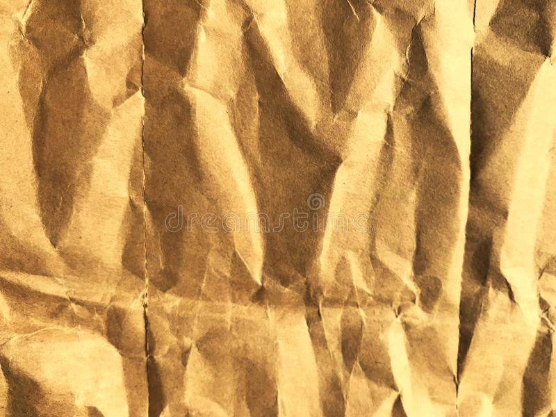Crumpled paper with dramatic yellow color in full frame stock image