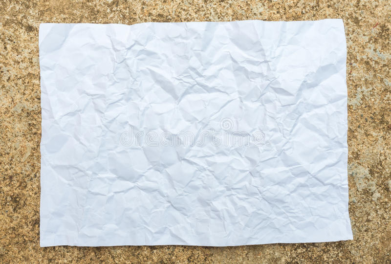 Crumpled paper placed on cement royalty free stock photos
