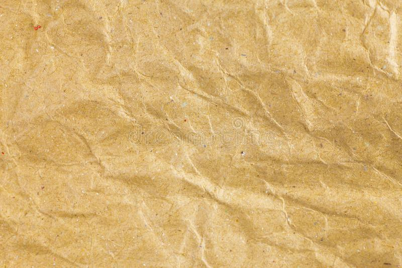 Crumpled paper texture background. Abstract, aged, antique, backgrounds, bag, blank, brown, bumpy, canvas, cardboard, close, closeup, color, copy, crease royalty free stock photo