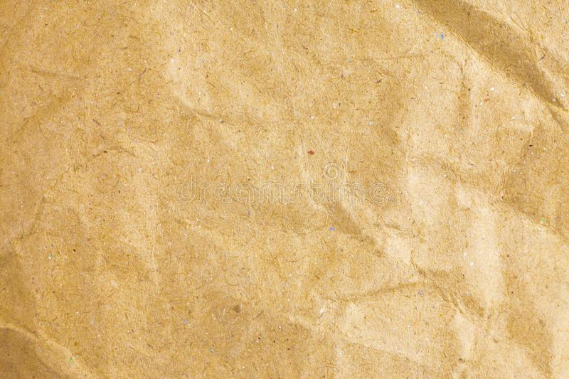 Crumpled paper texture background. Abstract, aged, antique, backgrounds, bag, blank, brown, bumpy, canvas, cardboard, close, closeup, color, copy, crease royalty free stock images