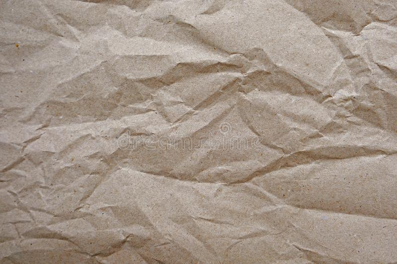 Crumpled paper texture for background. Rumpled kraft paper with copy space royalty free stock photo