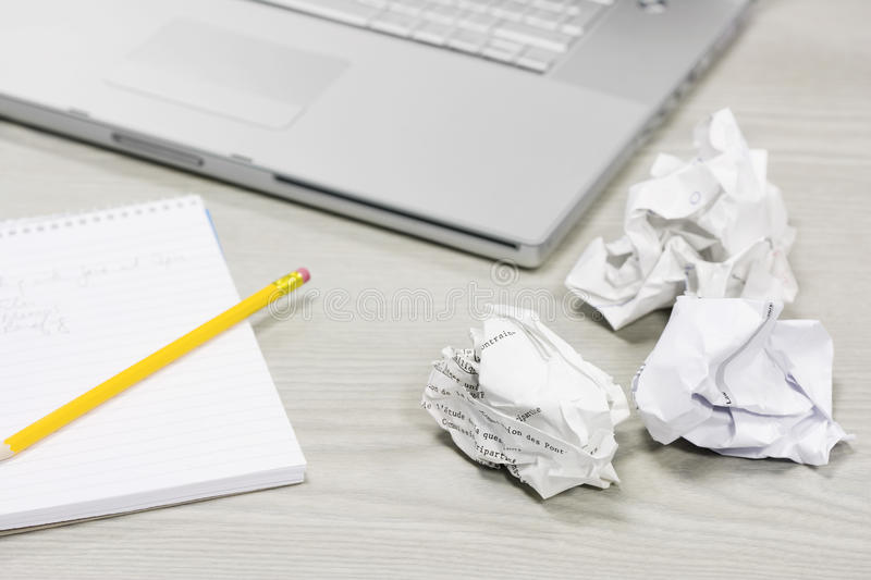 Crumpled Papers And Notebook On Desk stock photo