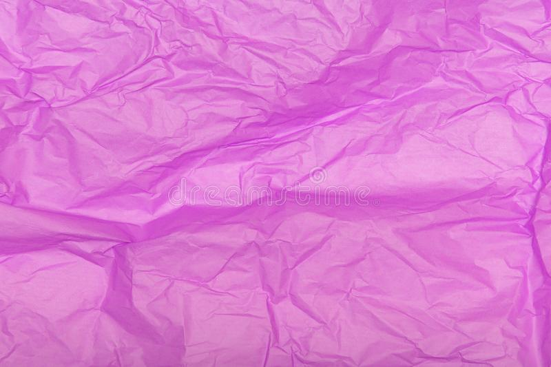 Crumpled pink paper texture as a background stock image