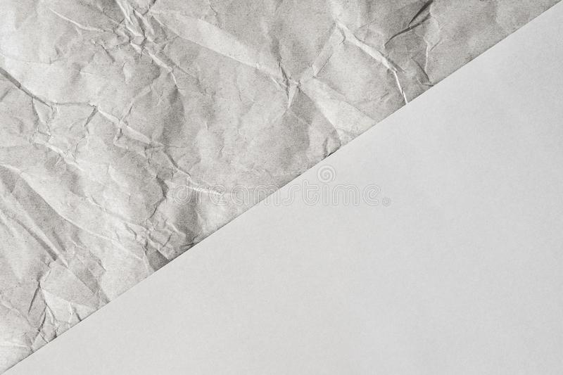 Neutral colored abstract background design. Crumpled and plain paper sheets divided in center creating line partition. Neutral colored abstract background design royalty free stock photography