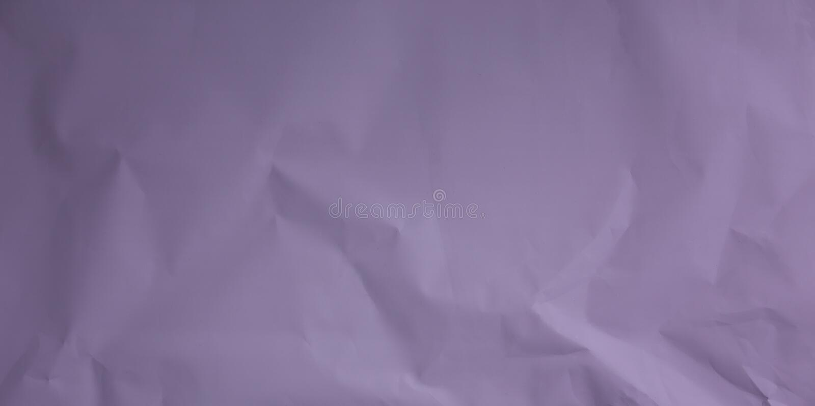 Crumpled purple paper. Vintage background for design royalty free stock images