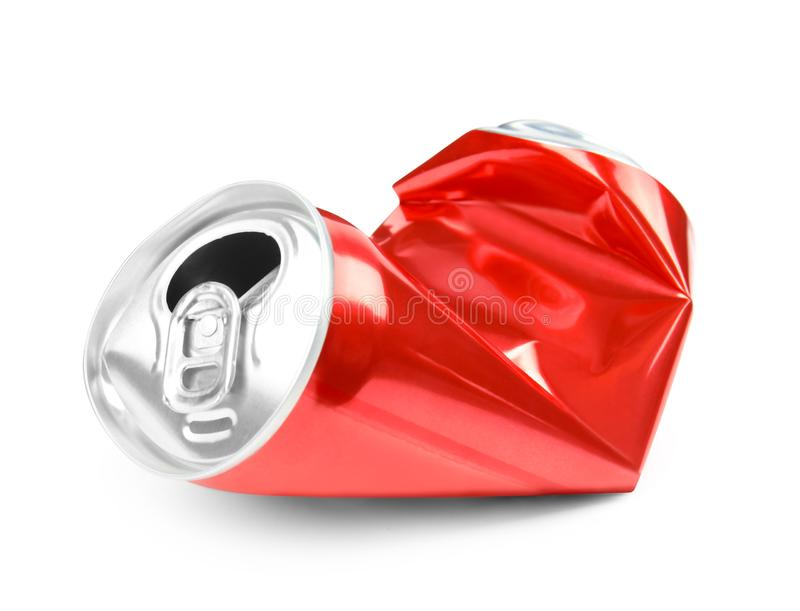 Crumpled red can on white background. Recyclable material royalty free stock photography