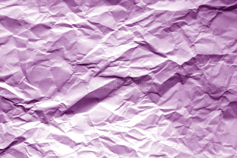 Crumpled sheet of paper with blur effect in purple tone. Abstract background and texture for design, color, surface, isolated, pattern, old, wallpaper, vintage stock photo