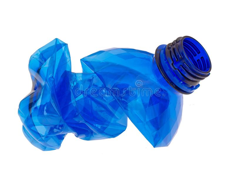 Crumpled and squashed blue plastic water bottle isolated on white background. stock image