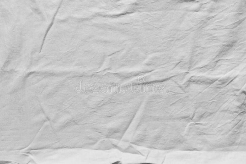 Crumpled white clean cotton texture. Wrinkled textile background, top view. Fabric shirt. Close-up royalty free stock photography