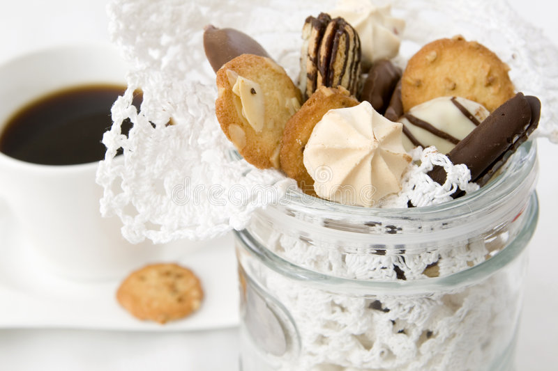 Crunchy, freshly baked cookies and hot coffee royalty free stock images