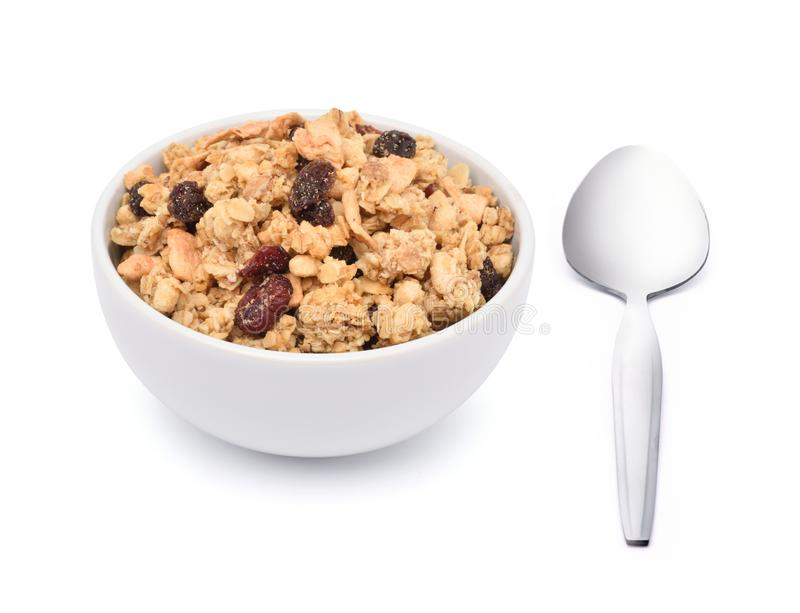 Crunchy oat granola cereal with dried fruits in white bowl stock photography