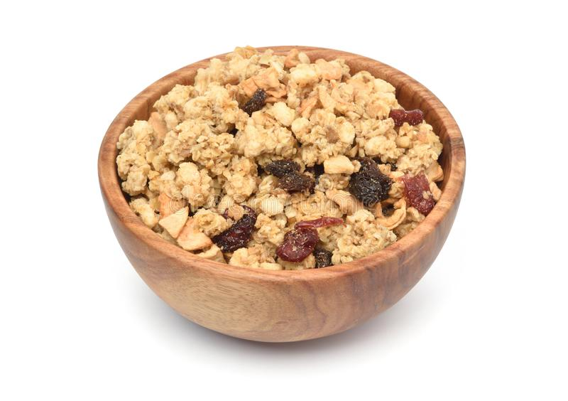 Crunchy oat granola cereal with dried fruits in wooden bowl royalty free stock photography