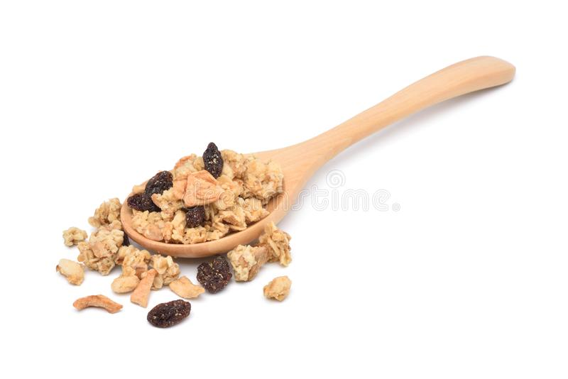 Crunchy oat granola cereal with dried fruits in wooden spoon stock images
