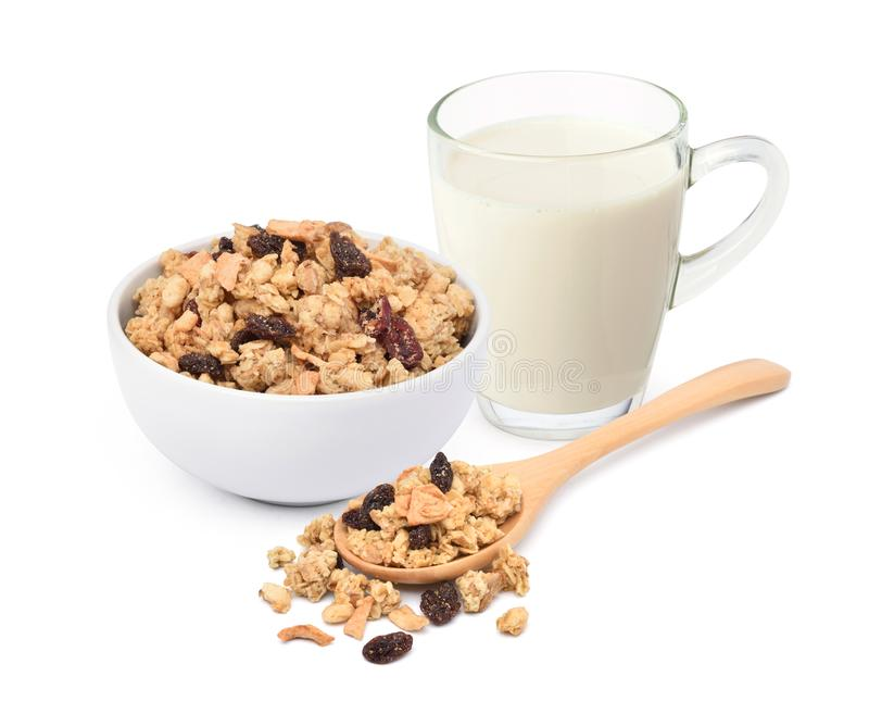 Crunchy oat granola cereal with glass mug of milk stock images