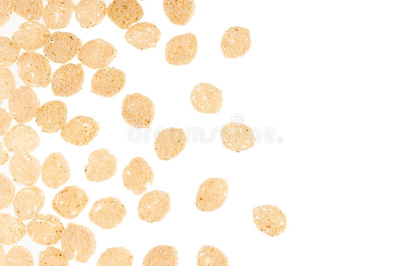 Crunchy pieces dry white bread as decorative border isolated on white background, top view. Fast food backdrop. Crunchy pieces dry white bread as decorative royalty free stock images