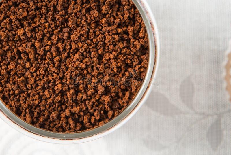 Crush coffee bean. A jar of crush coffee bean stock photography