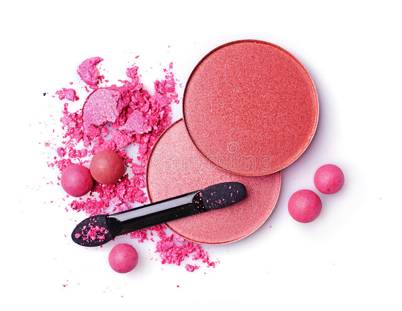 Crushed blush and eyeshadow with applicator. Isolated on a white background stock photo