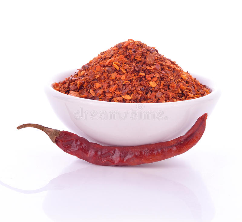 Crushed Chillies in the white ceramic bowl isolated. Hot chili, Red chili royalty free stock photo