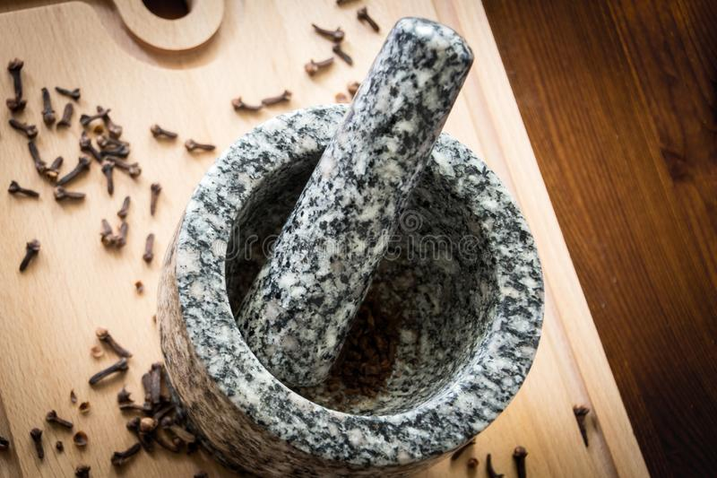 Clove with pestle and mortar stock images
