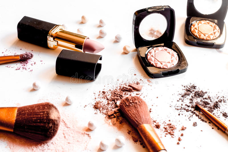 Crushed decorative cosmetics nude on white background close up.  stock photography