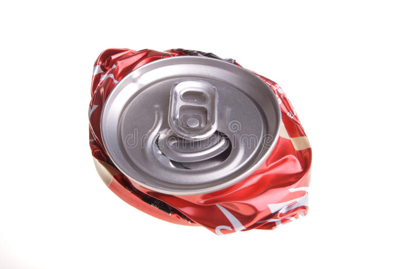 Crushed drink can. One crushed red soda can isolated on white background royalty free stock photos