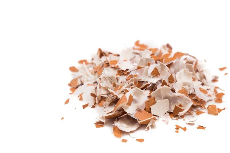 Crushed egg shell on white background flushed right.  stock photos