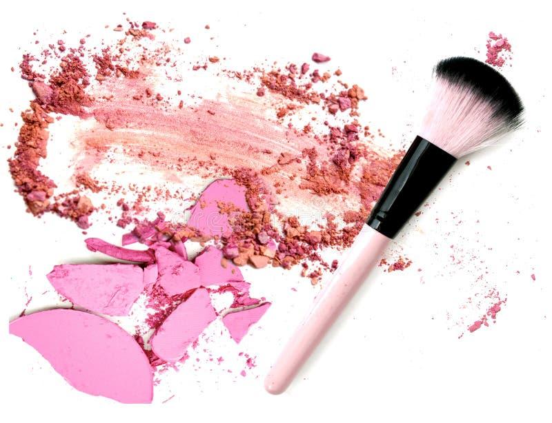 Crushed eye shadow with brush make up. Isolate royalty free stock photo