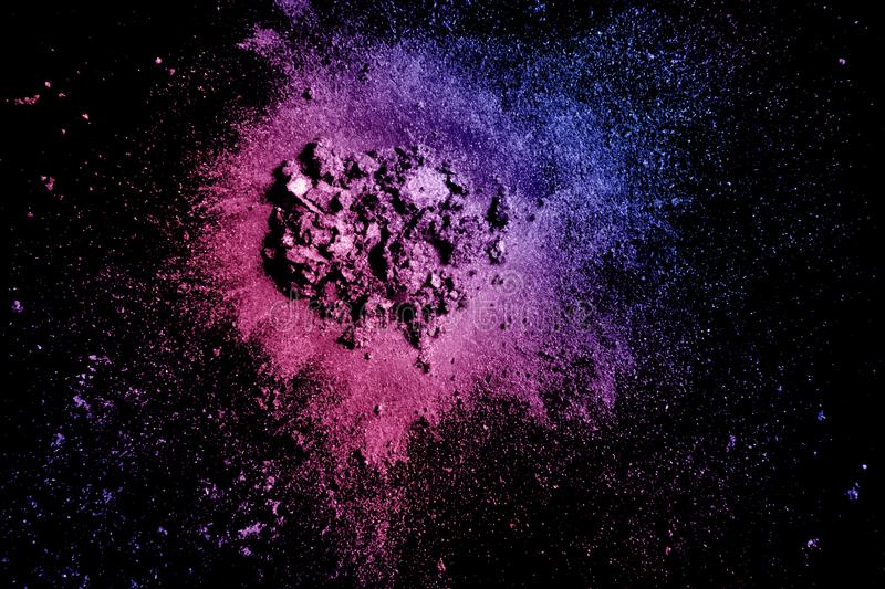 Crushed eye shadow texture. Neon palette make up powder swatch isolated on black background royalty free stock image