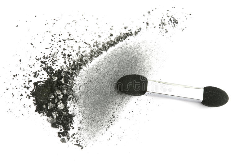 Crushed eyeshadow and applicator. Isolated on white stock photography