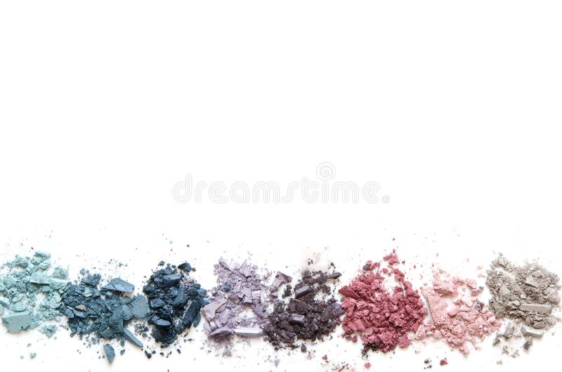 Crushed eyeshadow makeup set isolated on white background. The concept of fashion and beauty industry. Copy Space. Image royalty free stock photos
