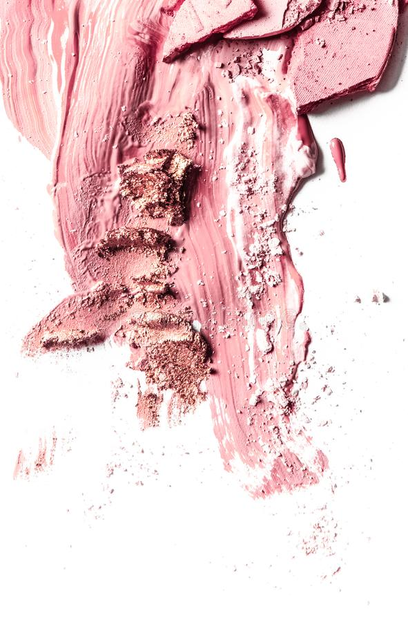 Crushed eyeshadow, powder and liquid foundation close-up isolated on white background. Beauty texture, cosmetic product and art of make-up concept - Crushed royalty free stock photography