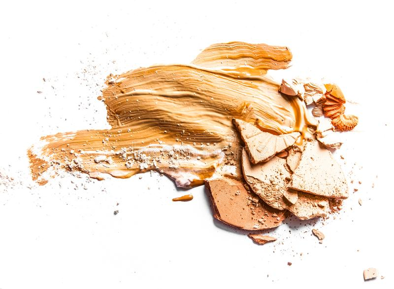 Crushed eyeshadow, powder and liquid foundation close-up isolated on white background. Beauty texture, cosmetic product and art of make-up concept - Crushed stock image