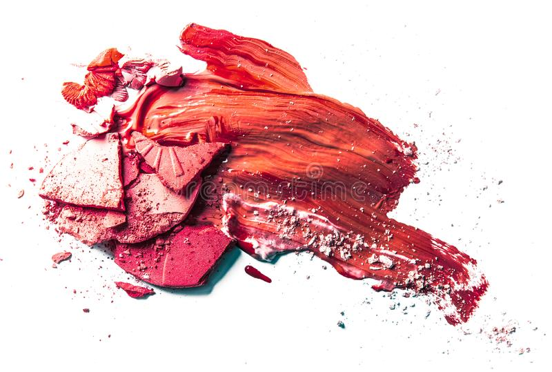 Crushed eyeshadow, powder and liquid foundation close-up isolated on white background. Beauty texture, cosmetic product and art of make-up concept - Crushed royalty free stock photos