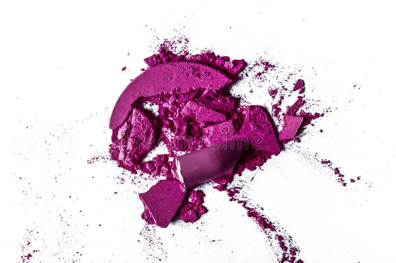 Crushed eyeshadows, lipstick and powder isolated on white background. Beauty texture, cosmetic product and art of make-up concept - Crushed eyeshadows, lipstick royalty free stock images
