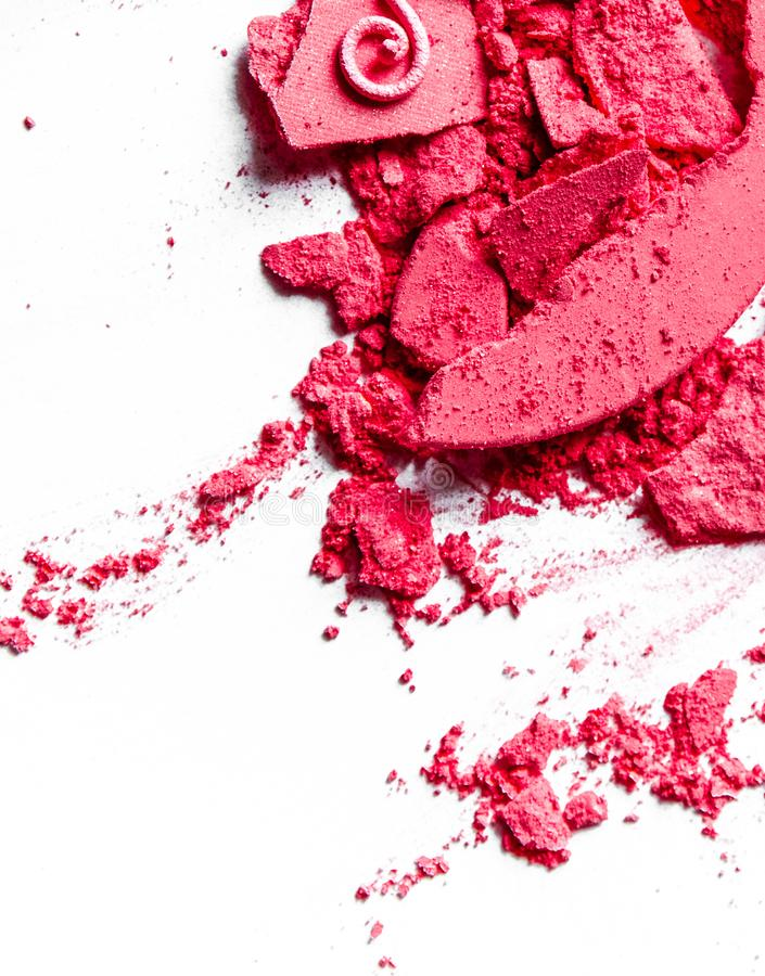Crushed eyeshadows, lipstick and powder isolated on white background. Beauty texture, cosmetic product and art of make-up concept - Crushed eyeshadows, lipstick stock image