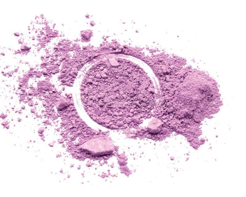 Crushed facial purple eyeshadow on white background. royalty free stock image