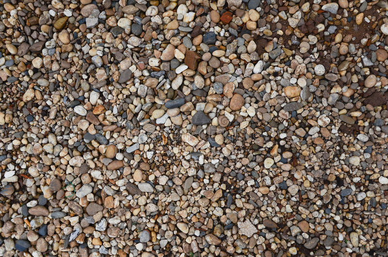 Crushed granite and pebble gravel texture stock photos