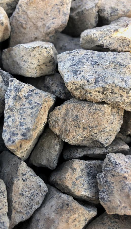 Crushed gravel texture, background. Hard, material, natural, rough, gray, nature, rock, small, stone, backdrop, closeup, construction, pattern, pebble, surface royalty free stock photography