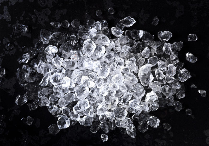 Crushed ice on black background. Top view, copy space stock photography