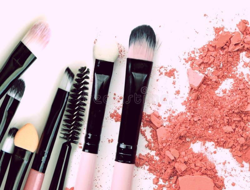 Crushed make up powder cosmetic. Brush make up set royalty free stock image