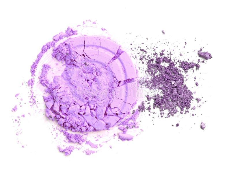 Crushed purple glitter eyeshadow isolate on white. royalty free stock images