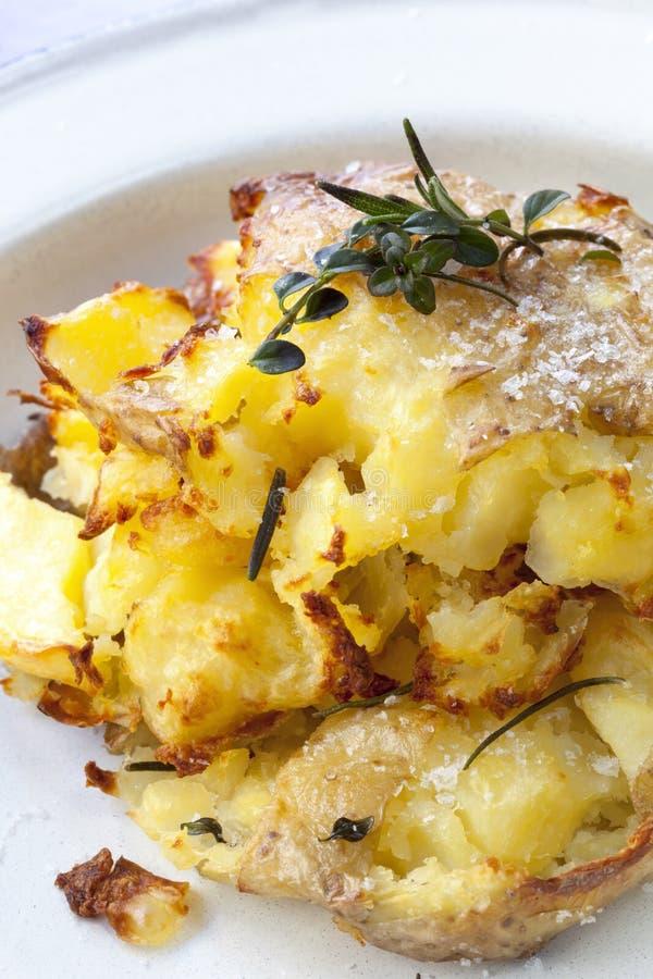 Crushed Roast Potatoes stock image