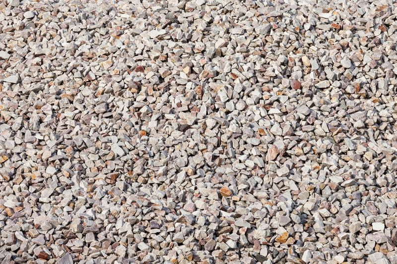 Crushed Stone Background Texture. Crushed stone background or texture, rail trail ballast used to hold the wooden cross ties in place, which hold the rails in stock images