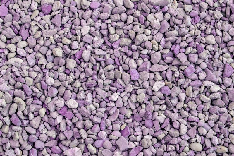 Crushed stone, purple tone texture abstract background royalty free stock images