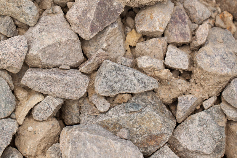 Crushed stone. Stone rock pieces, crushed gravel texture, can be used as background royalty free stock photo