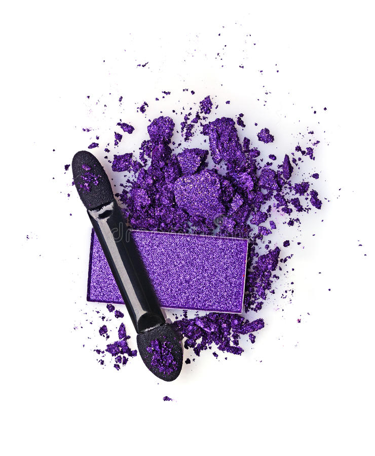 Crushed violet eyeshadow and applicator. Isolated on a white background stock photos