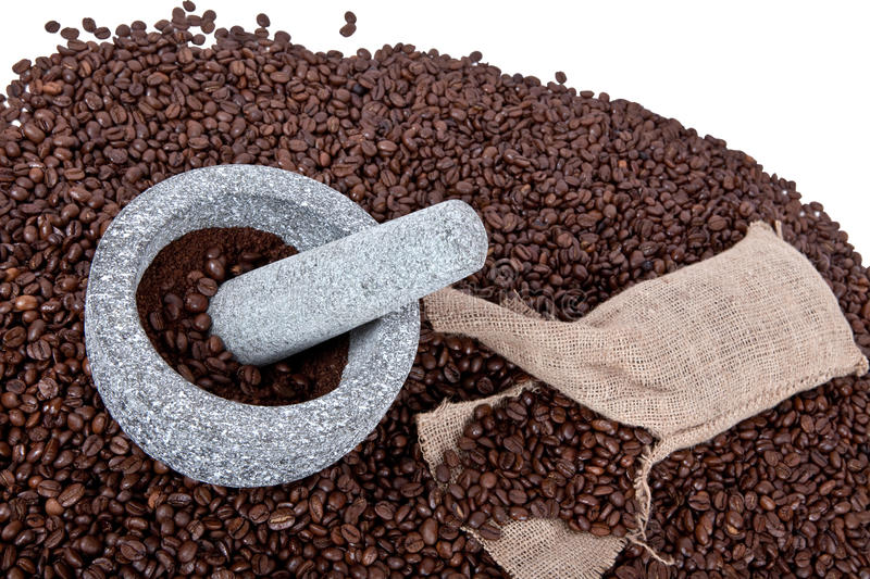 Crushing the beans. Crush coffee beans in a mortar stock images