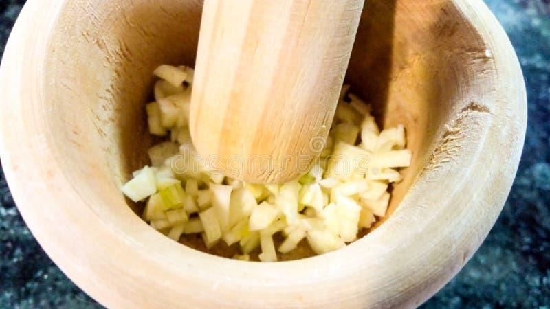 Crushing garlic royalty free stock photo